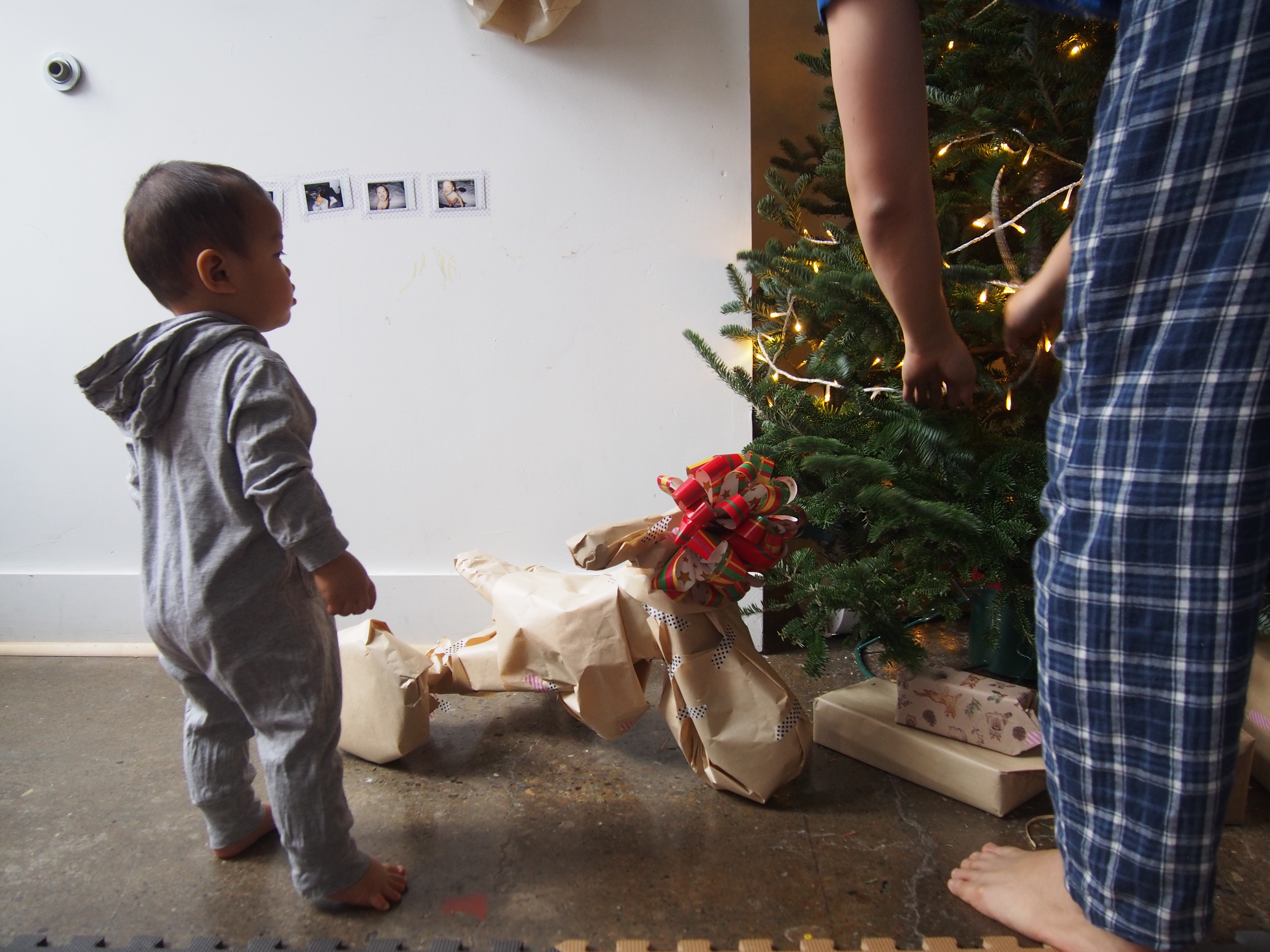 Jon, fixing the lights. Caleb, watching, unaware that his gift is in front of him.