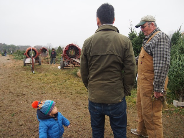 Caleb listening to the wisdom coming from our Christmas tree guide, in his farmer overalls. When I am a farmer, I too will be wearing overalls.