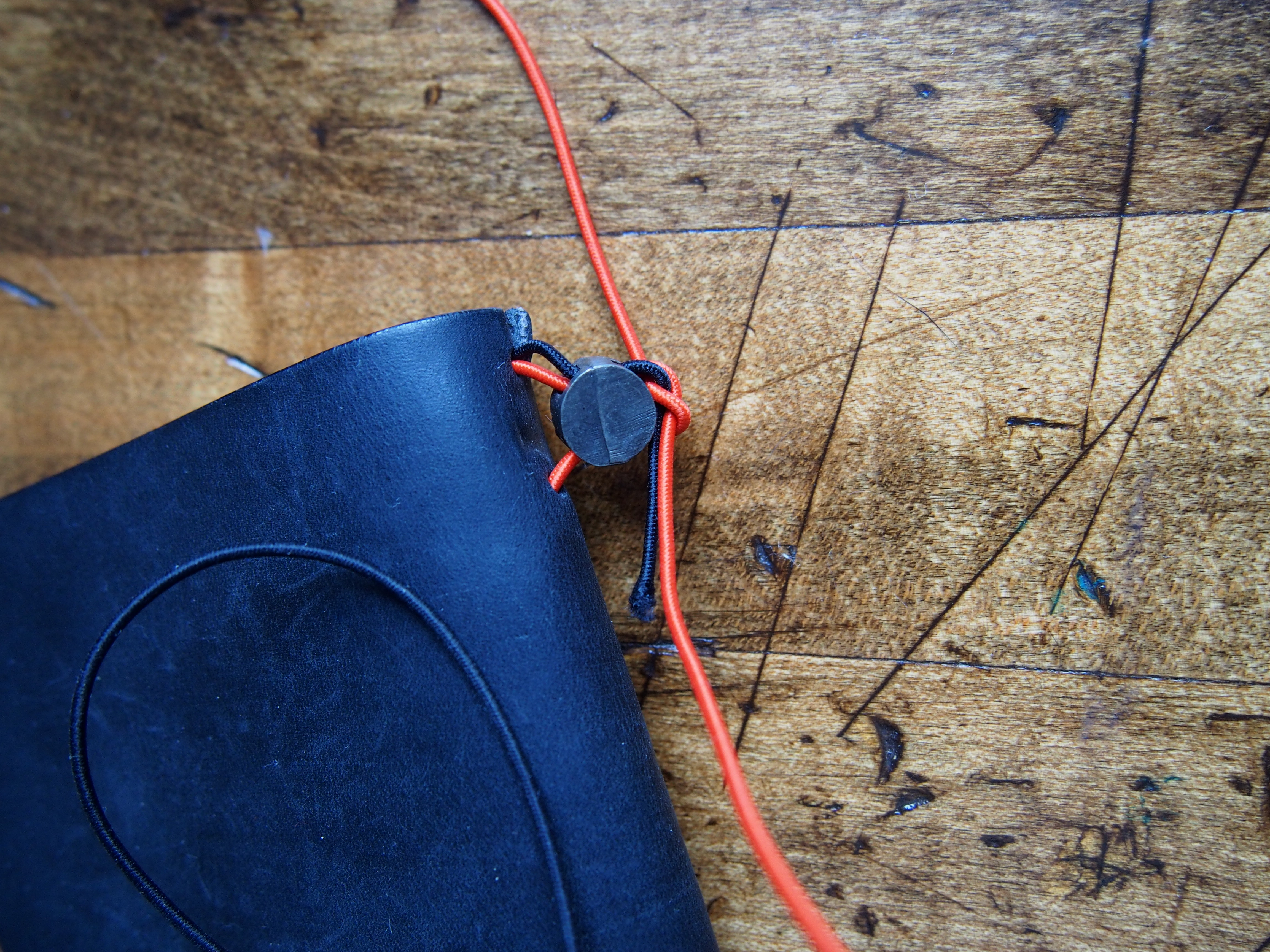 Step 7: Tie a knot. You'll be able to adjust the tightness now. And it's now or never, so take the time to make sure it's how you like. Better to err on the side of tightness, since the elastics can loosen up over time, but if it's too loose, you'll have to re-do the whole thing.